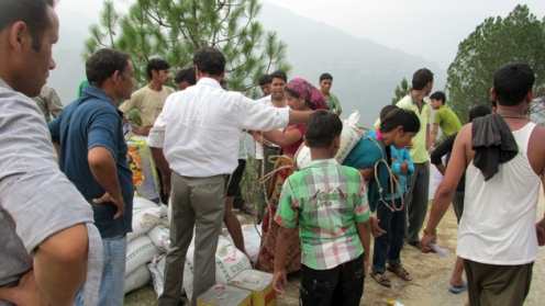 Villagers come and pick up rations